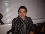 Dan smiling with short hair