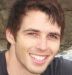 Dan smiling at the beach